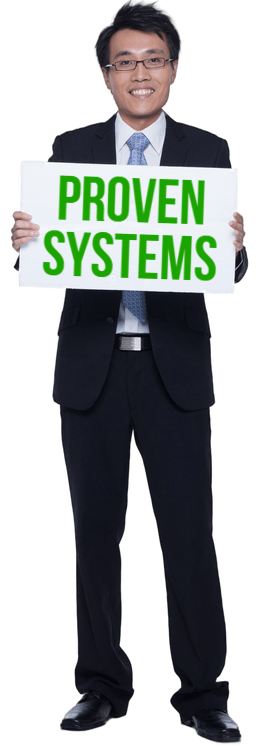 Dominic Tay holding a board on which Proven Systems is written, About Dominic Tay